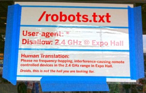 funny robots.txt sign at a conference