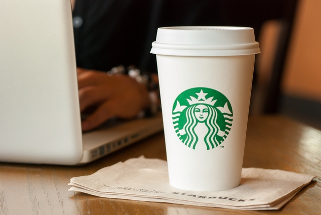 Developer drinking a cup of Starbucks